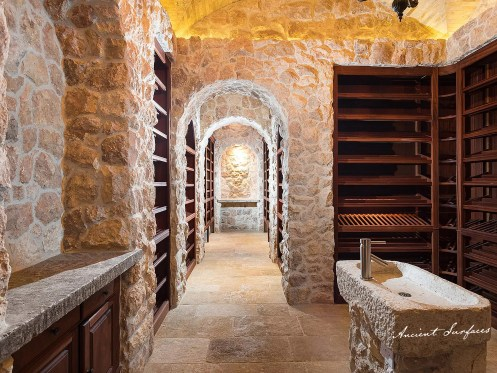 Antique-wine-cellar-with-limestone-wall-cladding-and-limestone-flooring-stone-floors