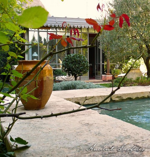 Outdoor-garden-with-limestone-pool-coping-stone-swimming-pool-biot-jar