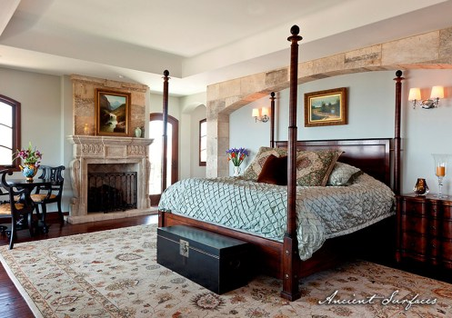 french-farmhouse-ancient-surfaces-bedroom-design-with-antique-limestone-fireplace
