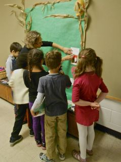 1st and 2nd graders displaying their ofrendas together