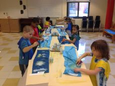 Students engaging in art in our Montessori PrePrimary early education program