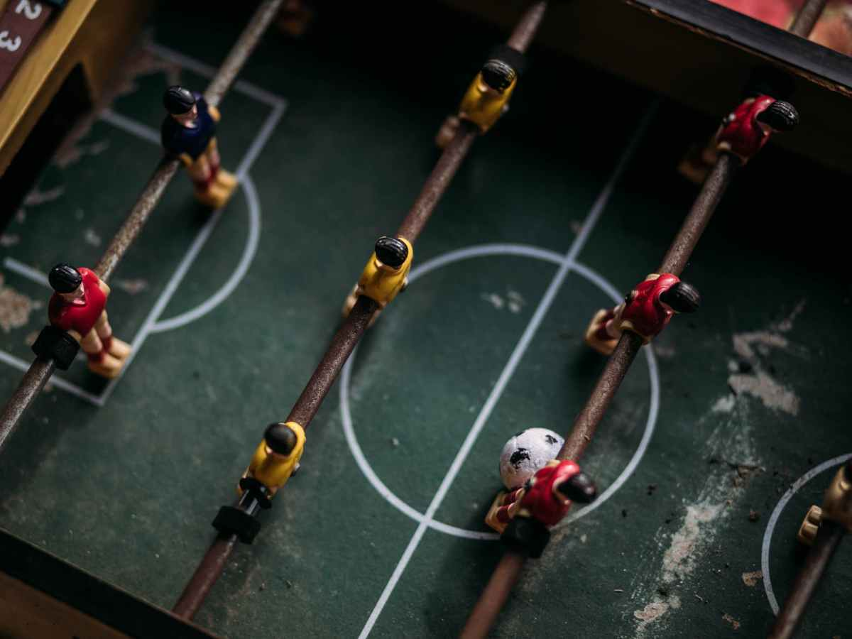 close up and top photography of football table