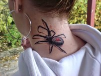 spider on neck