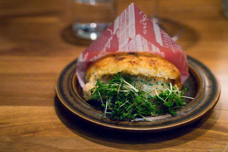 "Fermented celeriac bread with sour cream, ""løyrom"" and cress."