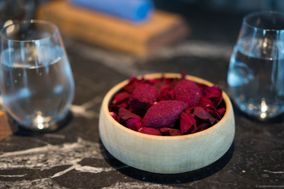Pickled red onion filled with yogurt, dusted with roses.