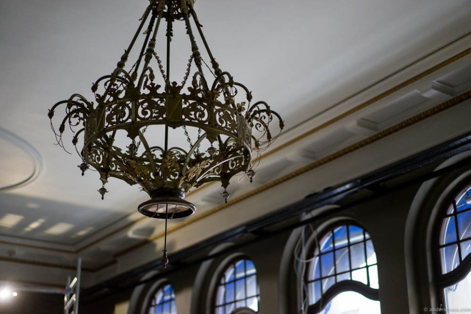 Chandeliers from another century hangs from the ceiling.