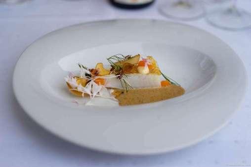 "Turbot with ""løyrom,"" onions, yarrow, and fermented lemon sauce"