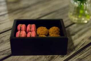 Chocolate and caramel macarons & lemon tartlets with raspberry