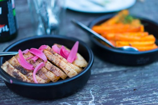 Danish pork with pickled onions. Carrots and seabuckthorn