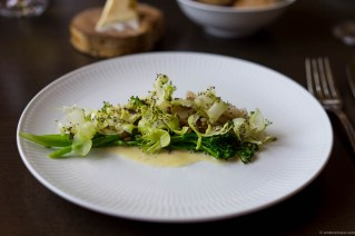 Steamed plaice with lardo, broccolini, roasted sunflower seeds and a sauce on asparagus juice and buttermilk