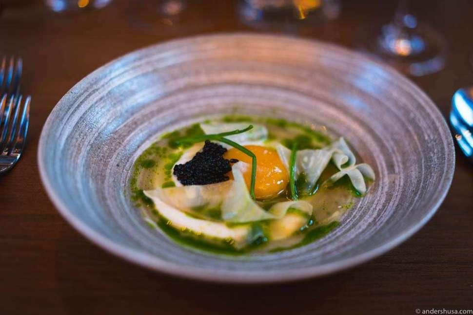 Celeriac cream, confit egg yolk from Holte Gård, Finnish sturgeon caviar, and a juice of celeriac, apple, and parsley.