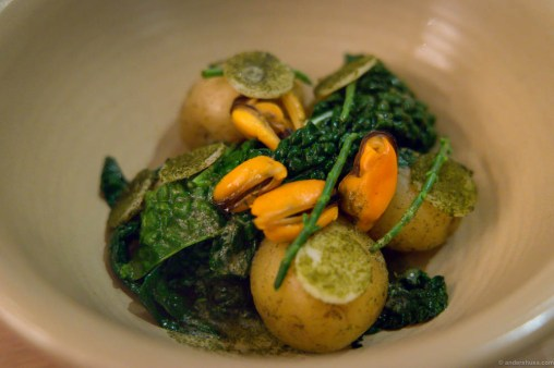 Unpeeled potatoes in butter, smoked mussels, romano salad, turnip kale, samphire & winged kelp powder