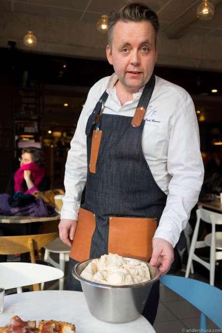 Head chef Sven Erik Renaa showcases the pizza dough