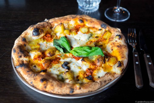Woodfired stoneoven pizza with potatoes, n'duja, mozzarella from Lillesand & basil
