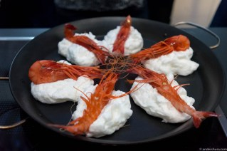 Cooking Dénia red king prawns on a mixture of egg white and salt on a hot pan