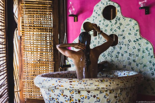 There are showers at Azulik, you have to wash your hair the old way with a coconut shell cup