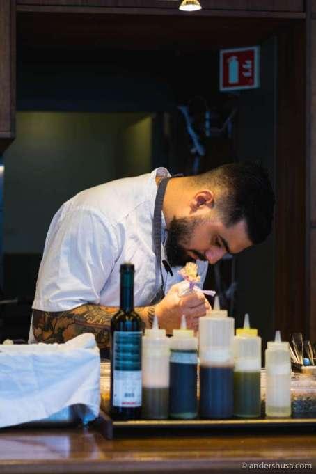Sous chef Szymon Sierant preparing the dish