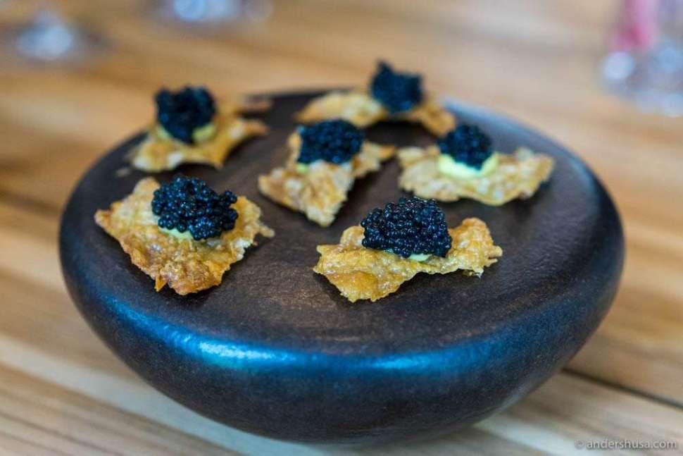 Crispy chicken skin with bitter citrus & Privilege Caviar