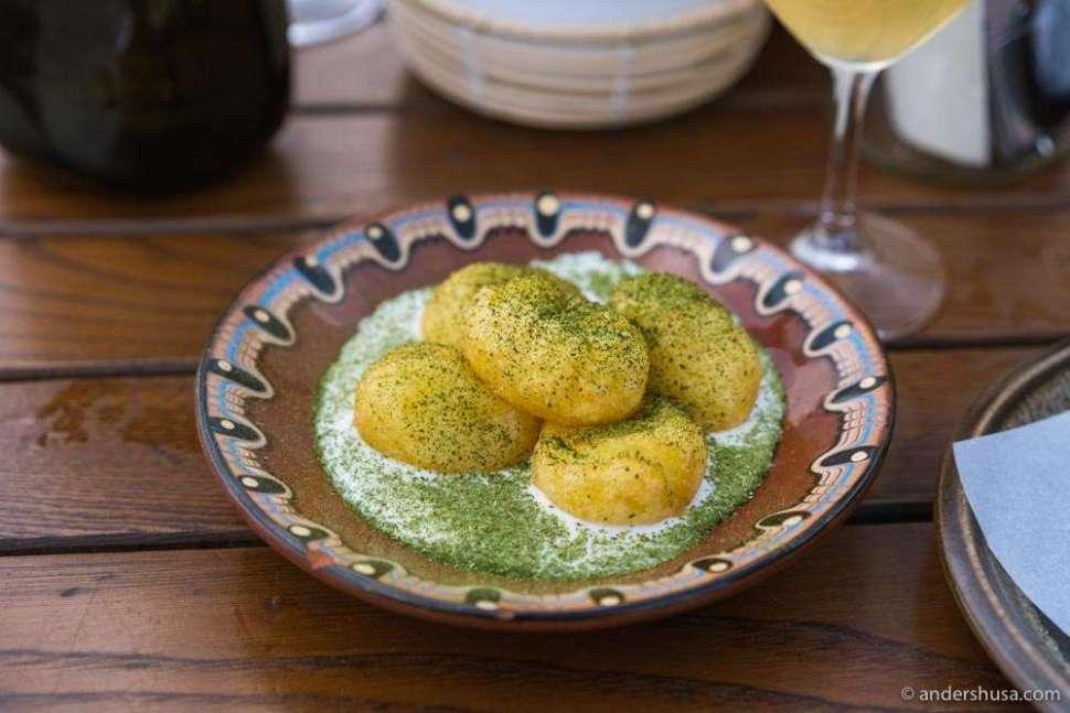 Crispy potato dumplings with sheep's cheese and lovage.