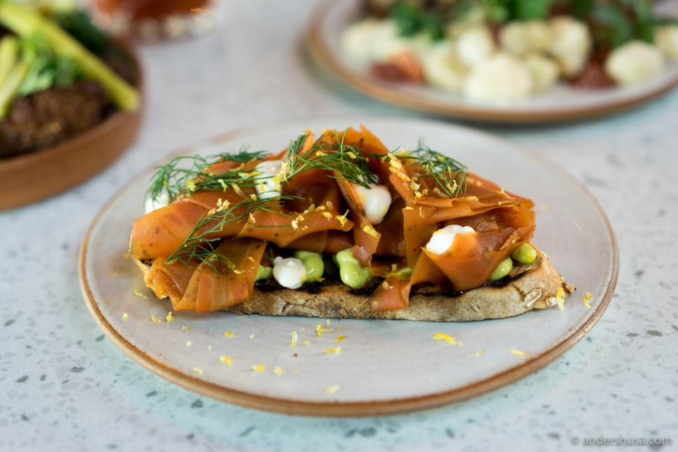 Smoked carrots cooked in soy and seaweed salt, on grilled toast with lemon and lovage vegenaise, and dill at no. 11 – Skál in Reykjavik, Iceland.