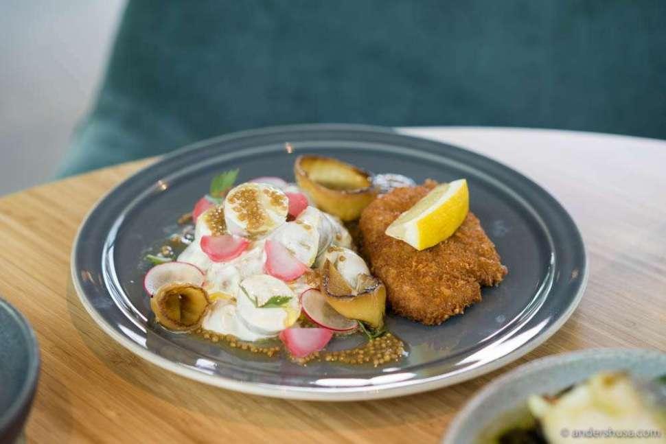 Veal schnitzel, potato salad, mustard seeds, burnt onions & radishes