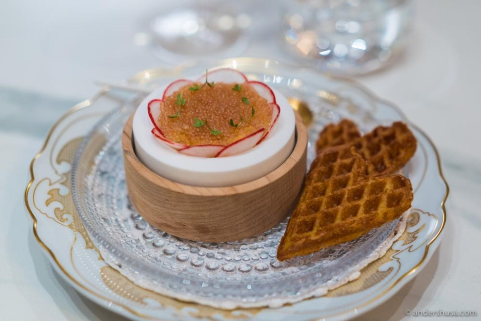 Crispy waffle made on «tjukkmelk» from Røros. Remoulade with smoked wild halibut from Senja, Nýr fresh cheese, fermented gooseberries, radishes, and a lid of lumpfish roe.