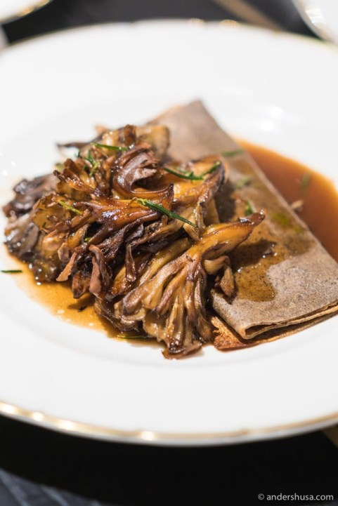 Roasted hen of the woods mushrooms with a buckwheat crepe.