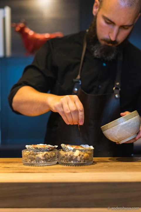 Chef José Cerdá prepares the oyster serving.
