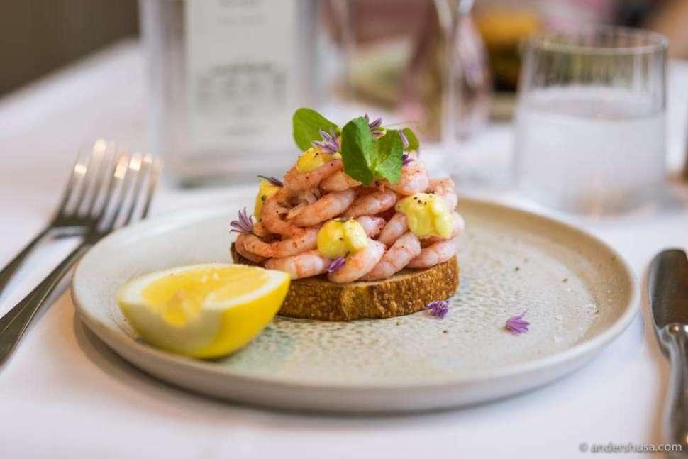 Shrimp on toast with mayonnaise, lemon, and herbs.