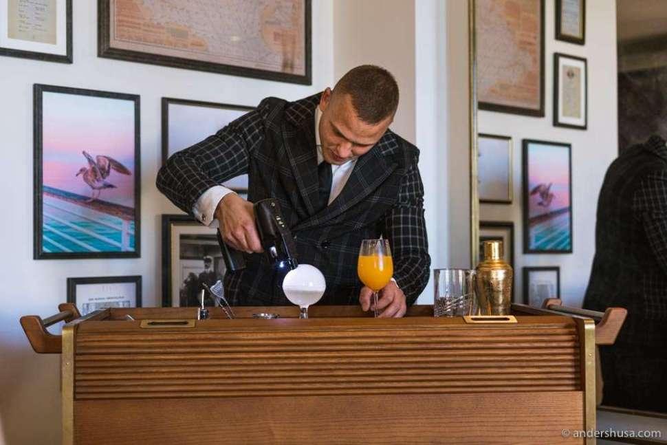 Passionate head bartender Adrian Michalcik making a drink.