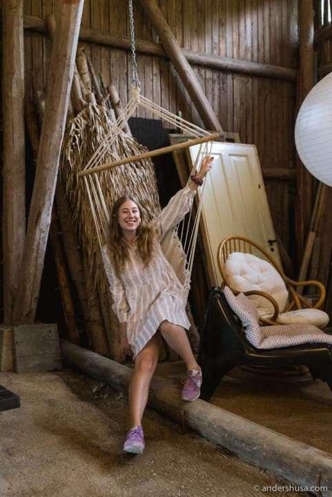 Kaitlin relaxing in a hammock swing.