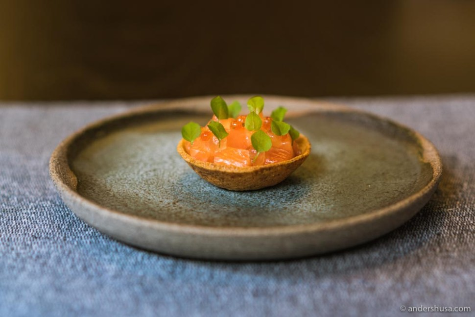 Nori tartelette filled with aged mountain trout, egg yolk, and roe.