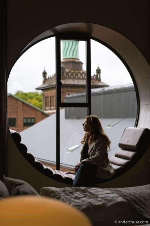The hotel's signature round windows overlook Bryggernes Plads.