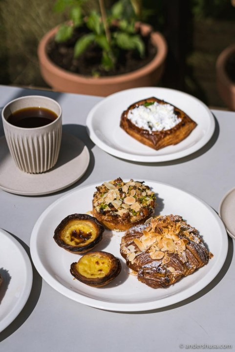 Two must-orders are the pastel de nata and the almond croissant.