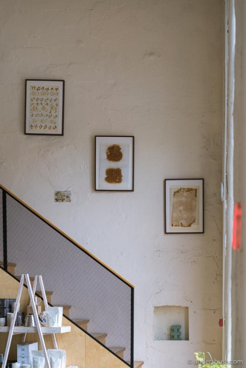 Old baking sheets hang on the walls as art, inspired by Petrus in Stockholm.