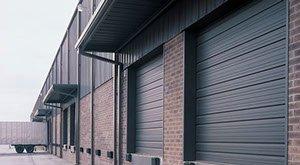 dark commercial garage door in Cache Valley, Ut