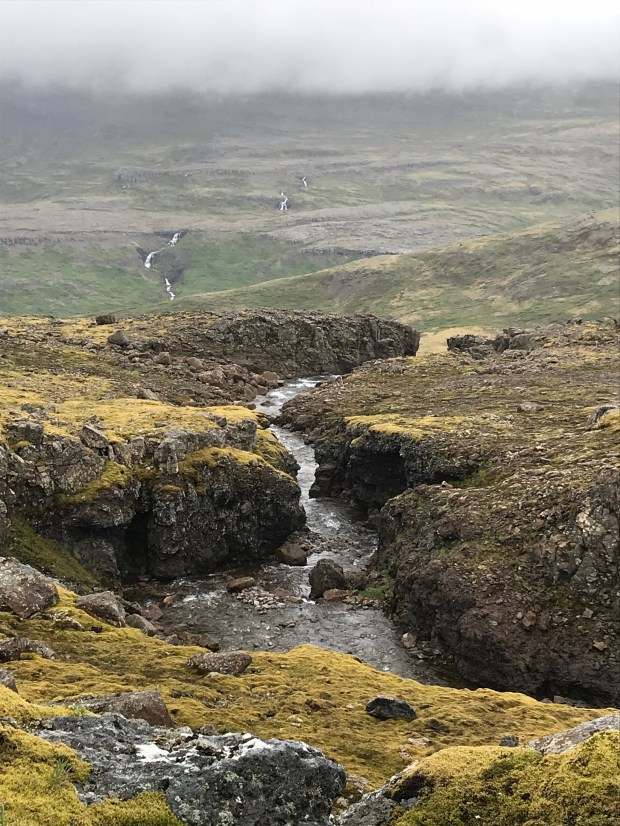 A Photo Diary of Iceland's Waterfalls | Andiamo Aurora | Iceland is home to waterfalls evoking wonder, isolation, comfort, and fear.  I believe the best waterfall is the one in front of you, not a top 10 list.