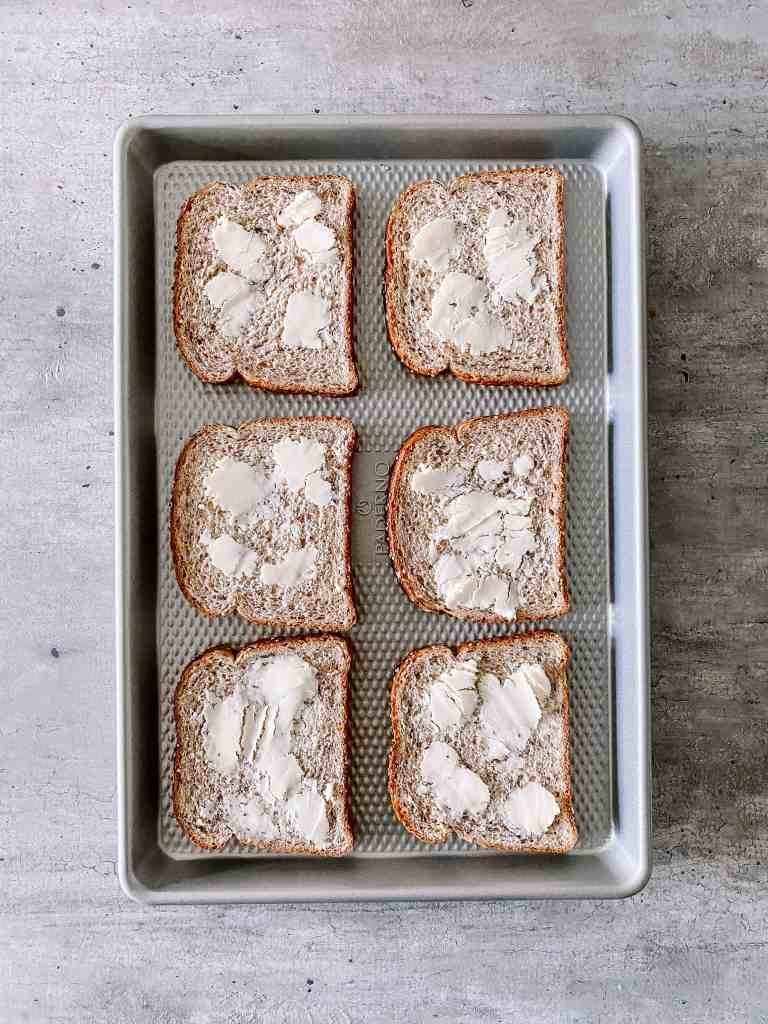 buttered bread on a sheet pan