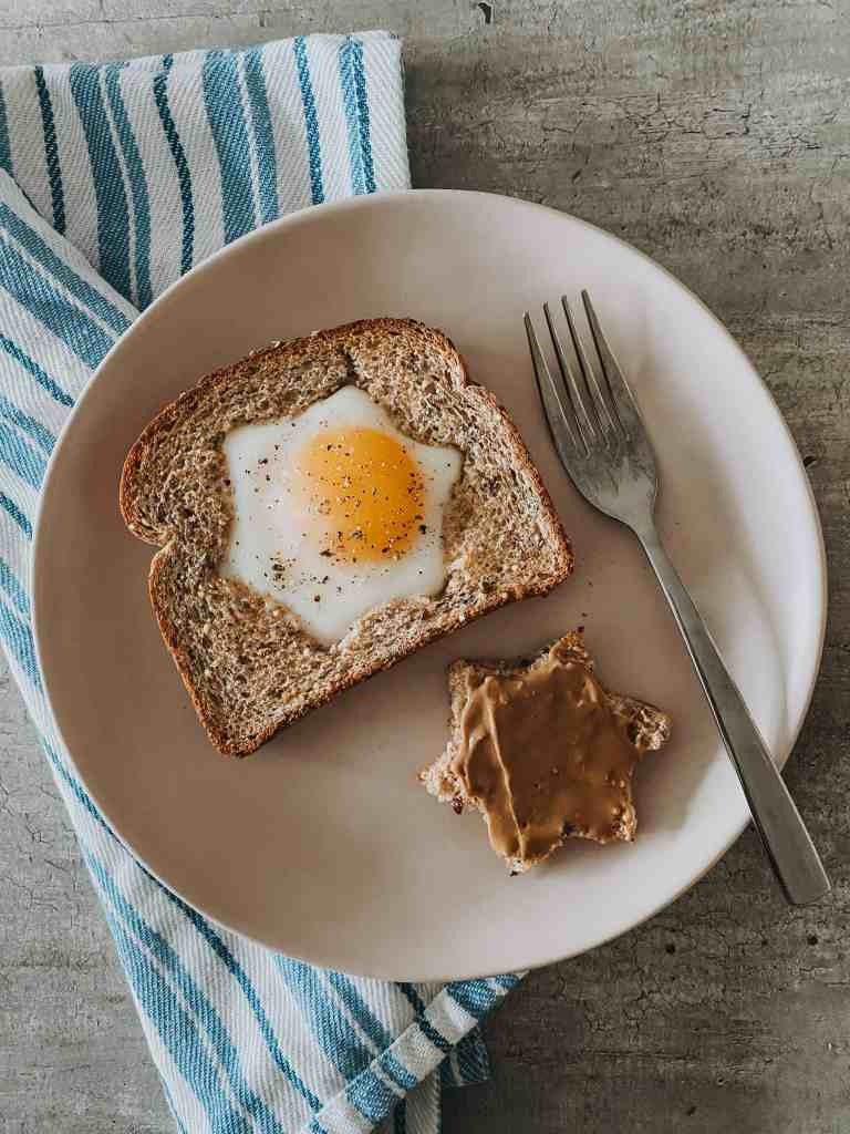 Baked Eggs In A Hole recipe on plate with fork