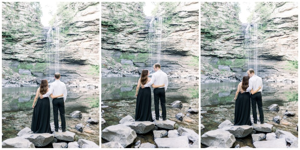 Couple stands with arm around each other staring at waterfall |Petit Jean Engagement|Waterfall engagement|  Petit Jean State Park| Tulsa Wedding Photographer| Arkansas Engagement| Destination Wedding Photographer|  Arkansas wedding photographer| Andi Bravo Photography| andibravophotography.com