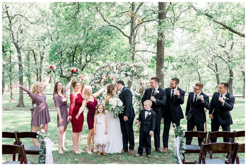 Bridal party celebrating at PostOak Lodge in Tulsa, OK  Tulsa Wedding Photographer  PostOak Lodge Wedding  Destination Wedding Photographer  Andi Bravo Photography