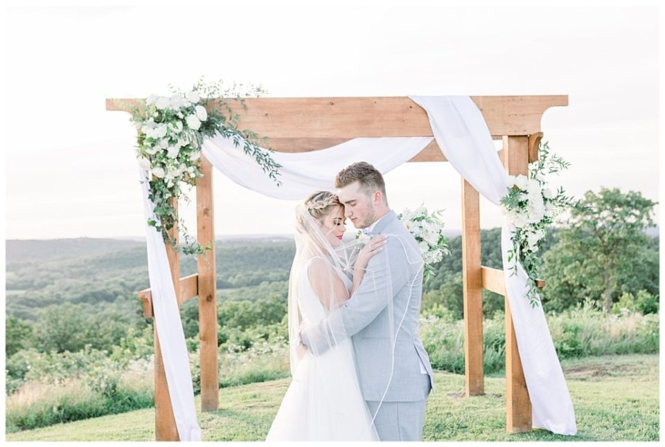 Bride and groom in gorgeous lighting outside at alter  Outdoor wedding  The View At Hillside Barn Wedding  Countryside Wedding   Tulsa Wedding Photographer  Andi Bravo Photography