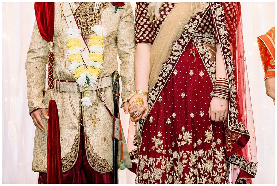 Bride and groom join hands at Hindu wedding ceremony Tulsa| Hindu wedding attire bride and groom| Crimson and gold Hindu wedding| Tulsa wedding photographer| Andi Bravo Photography