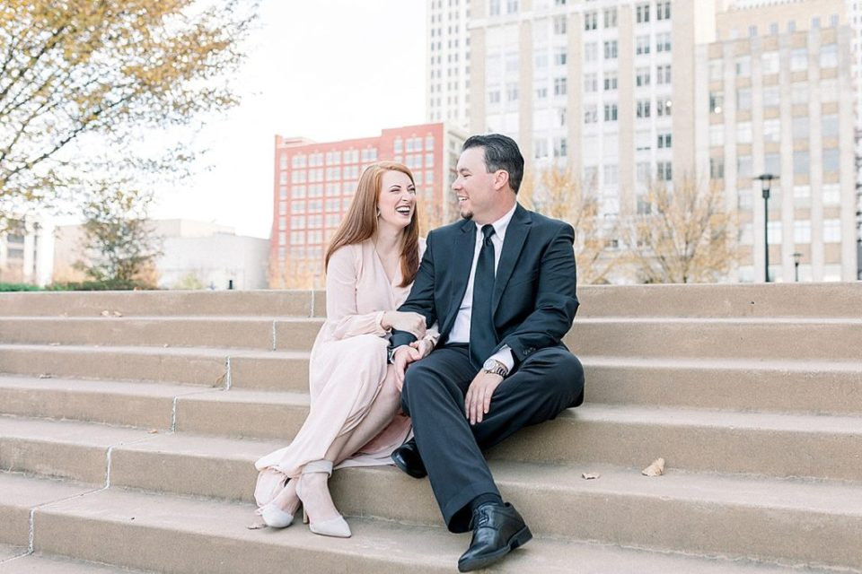 Couple laughing on stairs in Downtown Tulsa