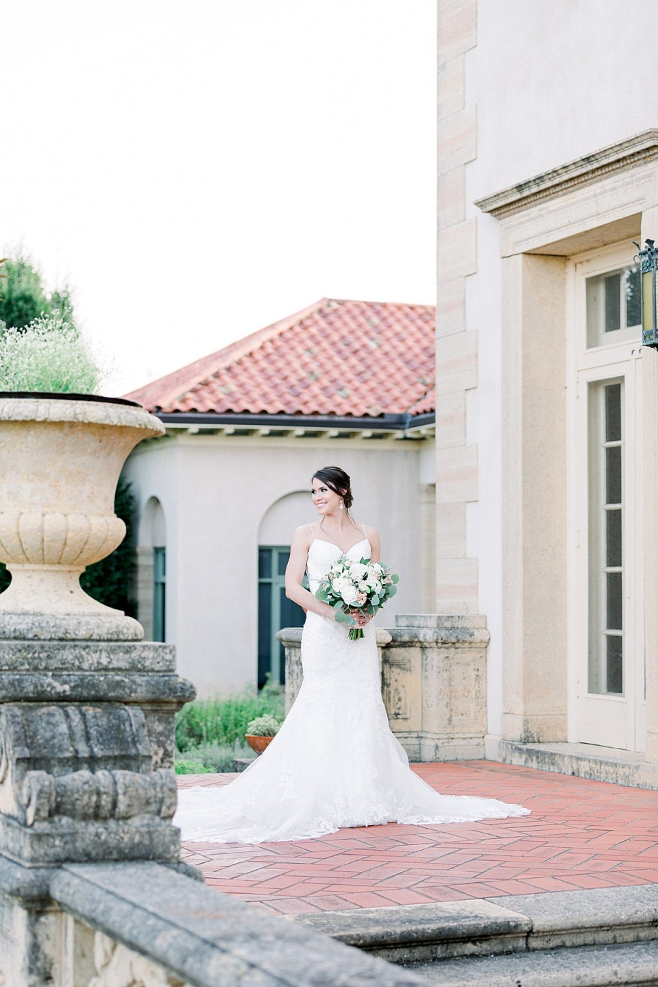 Bride standing holding bouquet at Tulsa Philbrook