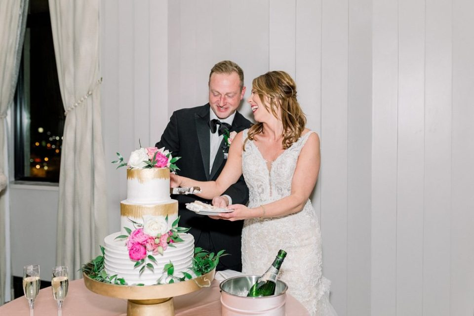 Bride and groom wedding cake cutting