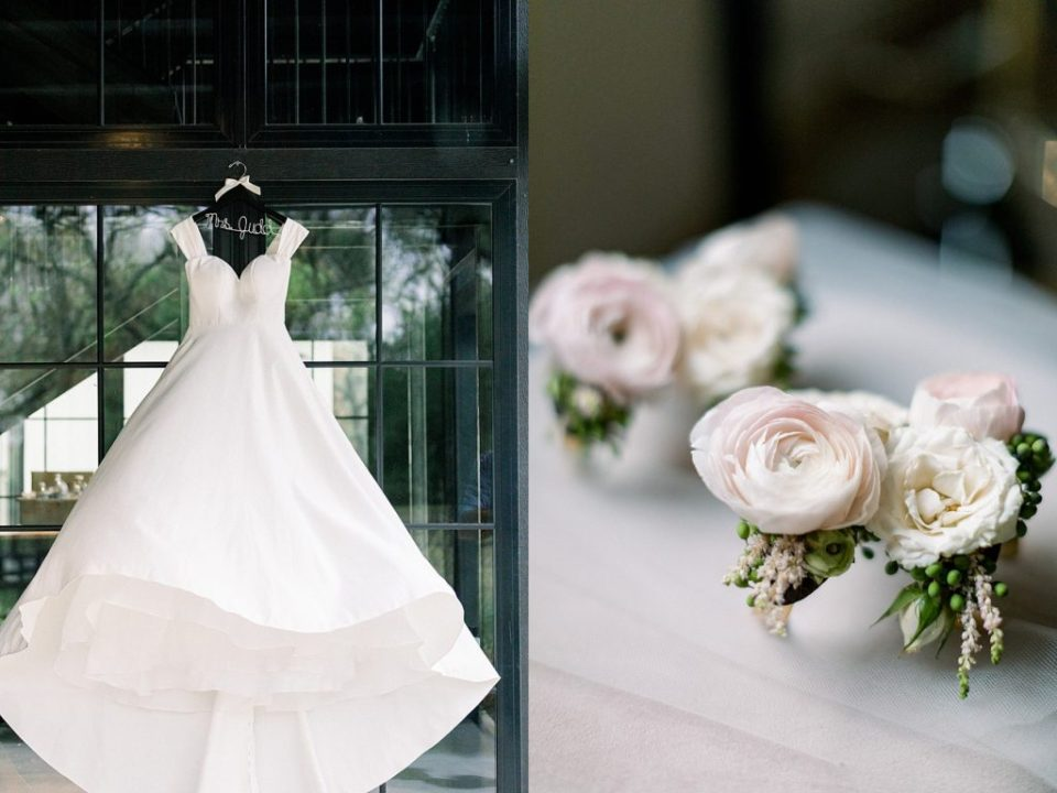 Wedding dress on personalized hanger and white and pink rose boutonniers