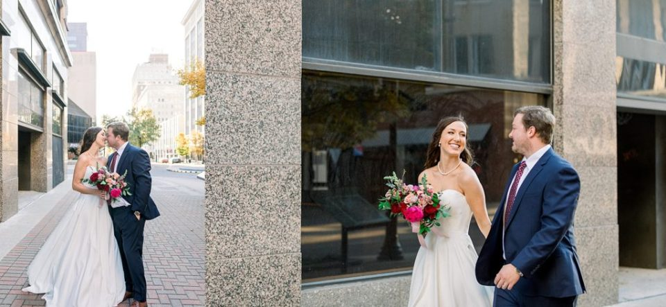 Bride and groom walk hand in hand downtown Tulsa