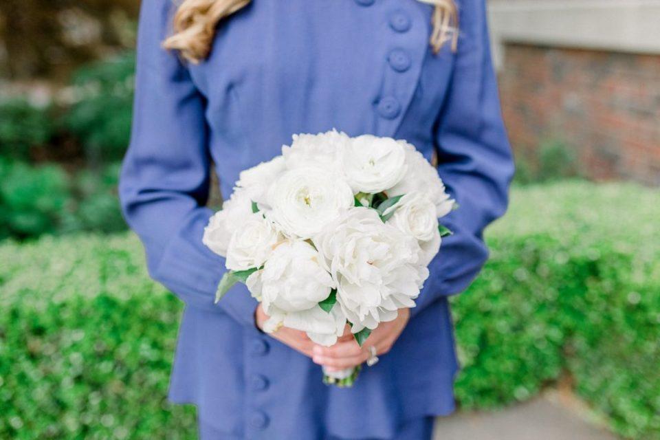 Person holding white bridal bouquet
