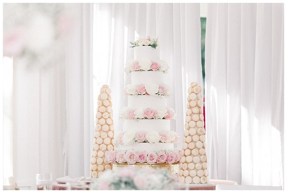 5 tiered pink and white wedding cake and macaroon towers